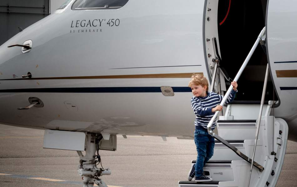 Young Boy Boards an AirSprint Private Jet
