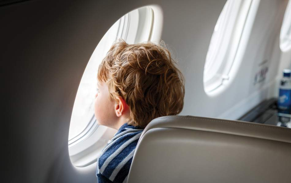 AirSprint child passenger looking outside of window
